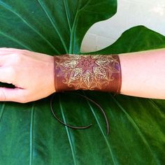 Embroidered leather cuff One of a kind!  Reclaimed leather with a mandala embroidered on it in yellow, golds and browns.  Has a corset closure for comfort fit. Jewelry Bracelets