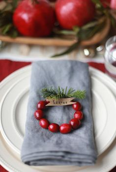 How adorable are these? They're easy to make – just string cranberries onto a piece of wire, twist the wire around, add pieces of tree trimmings, and attach flag-shaped kraft paper tags onto each one.