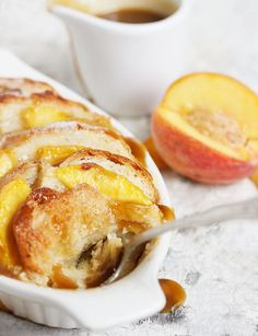 Peach Bread Pudding with Warm Brown Sugar Sauce Peach Bread Pudding - served with a warm brown sugar sauce. A lovely dessert any time of year, but especially nice with summer fresh peaches! Peach Bread Puddings, Best Bread Pudding Recipe, Just Desserts, Delicious Desserts, Yummy Food, Pudding Desserts, Pudding Recipes, Dessert Crepes, How Sweet Eats