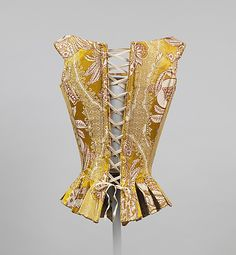 Back view, stays, Italy, 1770s. Yellow silk brocade with floral design. Front and (wrong) back lacing.