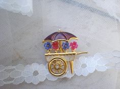 Beautiful Flower Cart Brooch with Umbrella and by SarahsBasket, $19.99