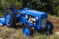 https://flic.kr/p/xeCumE | Dressed in Blue | This old tractor is in Oklahoma City.