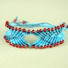 Make a macrame bracelet in chevron style with beads and diamond.