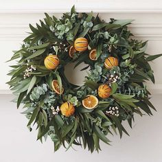 Because of its scent, this Orange Eucalyptus Wreath ($89-$98) would fill a room with fragrance and seasonal colors.