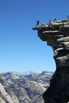 Darrell on the diving board. Top of Half Dome in Yosemite.