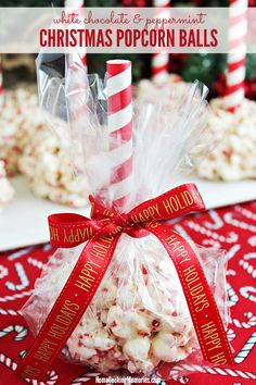 These are so fun! White Chocolate & Peppermint Christmas Popcorn Balls recipe for an easy holiday treat that's perfect for parties or for Christmas food gifts.