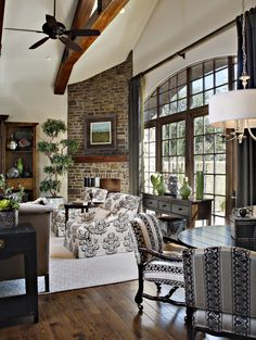 There's a lot going on in here but I love the high ceiling, exposed beams, and floor to ceiling windows!  Yes!!