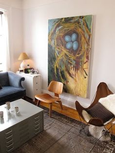 Like the size of the nest painting with the skinny drop-leaf end table and the flat file coffee table: unique combination.