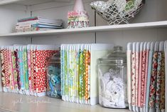 Sweet way of storing and displaying pretty fabric. In this specific example, it is in generally small quantity.