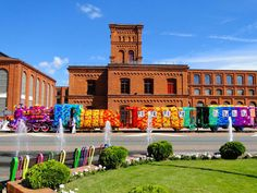 Crocheting a Locomotive in Lodz, Poland | Although currently living in the United States, crochet artist Olek recently returned to her native country of Poland for an epic project. Over the course of two straight (and rainy) days, Olek and her team of four assistants 'yarn bombed' an entire locomotive with two freight cars in tow. Olek had already crocheted many of the panels beforehand but they still had to be assembled to cover the train.