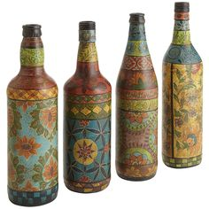 old wine bottles become hand-painted bottles, unique and exuberant. Vivid floral designs demonstrate the impressive resourcefulness of artisans upcycling common bottles into works of art.