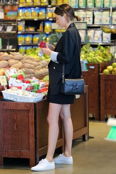 Miranda Kerr wearing Celine Symmetrical Bag and Common Projects Original Achilles Leather Sneakers