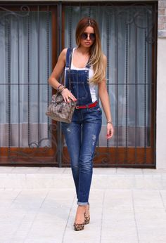 Are over alls making a comeback?! I must say I like the skinny jean style leg part so much better!! Along with the red belt and cheetah shoes hello fashion styles for 2014 :)