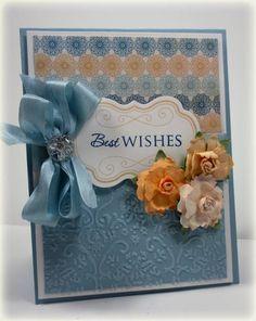SU Baja Breeze, Whisper White cardstock. MME Stella & Rose Hazel dsp. Button, CB embossing folder.