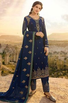 This Dark Blue Satin Georgette Trouser Suit which makes it astonishingly charming. Present with Satin Georgette Trouser in Dark Blue Color with Dark Blue Georgette Dupatta. Trouser has Resham, Zari and Stone work. Dupatta embellished in Resham, Zari and Stone Work.