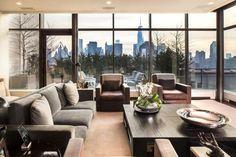 Penthaus Wohnung neutrale Farbe einrichten Ideen Glas Fassade schöner Blick