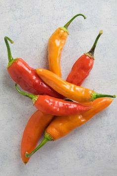 """Aji peppers are known as the Peruvian hot pepper, where """"aji"""" is the name in South America and the Caribbean for chili peppers. Learn more about Aji chili peppers from Chili Pepper Madness. Tuna Recipes, Chili Recipes, Sauce Recipes, Raw Food Recipes, Aji Amarillo Paste Recipe, Peruvian Sauce Recipe, Yellow Chili Peppers, Red Peppers, Coconut Oil Weight Loss"""