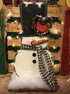 A cute wooden snowman with a checked fabric scarf. www.facebook.com/TommypieCreations