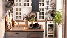 Small kitchens are awesome too! Specially when they're designed to use every nook and cranny.