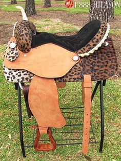 cheetah print saddle--- Sara Hanson; thought of you!! I don't ride horses but, with this saddle, I might start.