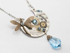 Steampunk dragonfly necklace on a silver pocket watch plate featuring pearls blue Swarovski crystals and gears