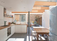 "North London house extension by Denizen Works transforms a ""small dark bachelor pad"" into a family home with a light-filled kitchen and dining space Kitchen Diner Extension, House, Interior, House Extensions, Home, London House, New Kitchen, Home Kitchens, Kitchen Design"