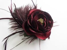 DIY Flower Corsage + Hair Clip - The Sweetest Occasion >will have white & red feathers with the lg red roses in stock = perfect to add colour to the black tops with the red skirts.