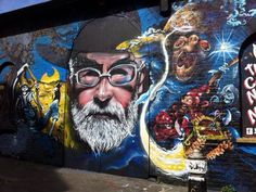 The East London graffiti tribute to author Terry Pratchett - The London mural is the impressive result of work by the muralists Dr Zadok and Jim Vision. The Bristol mural was made by the artist Fiver. Discworld Characters, Discworld Books, London Brick, Terry Pratchett Discworld, Country Bears, Fantasy Authors, Colorful Artwork, Street Art Graffiti, Graffiti Artists