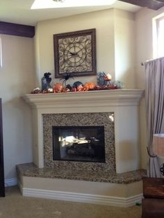 fireplace raised hearth updated with wood trim - Google Search