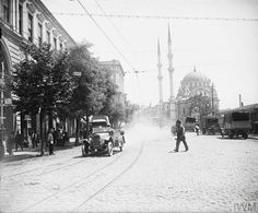 British officers in a Sunbeam car, motor dispatch rider and lorries of the MT Company, ASC in the Rue de Tophane, Constantinople. British Army, Istanbul, Louvre, Street View, Building, Travel, Outdoor, Pictures, Outdoors