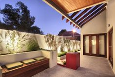 Small Courtyards - The Garden Light Company Photo Gallery - Love the potential of the red tile feature.