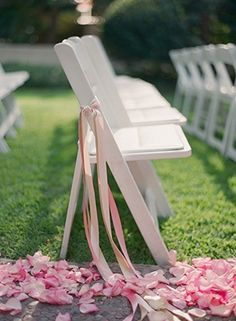 White chairs with pink ribbon. Photo by Esther Sun Photography. www.wedsociety.com #wedding #chairs