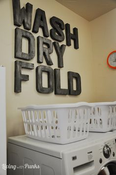 Love these large scale letters -- adds great interest to a boring room.