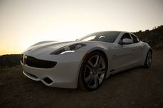 "The Fisker Karma EVer (Electric Vehicle with extended range) is a $100,000, four-door, four-seat, luxury plug-in hybrid with a very strong presence. It can travel up to 50 miles on a full charge of its 180 kW, 20 KWh lithium-iron phosphate battery pack, meaning that most people commuting to work will never need the turbocharged 2.0 liter, four cylinder, 260-hp gas-powered engine (sourced from GM). This ""series hybrid"" design is unique to the Karma."