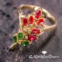 Gold Indian Paintbrush Ring, a Texas wildflower to behold! Accented with Padparadscha sapphires, fancy yellow diamonds, and green Tsavorite garnet leaves.