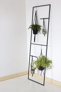 A versatile display ladder for plants, bathroom linens, or kitchen pots and accessories. Welded Steel frame in matte black. All handmade in