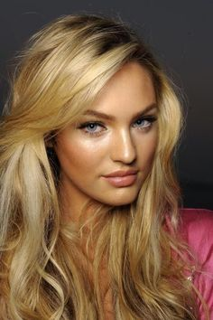 Interesting that in this picture, at this angle, Candice Swanepoel almost resembles a blonde Miranda Kerr.
