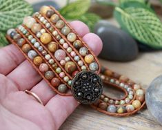 5 Row Wide Beaded Leather Cuff  This earth tone Bohemian bracelet features stunning agate semi precious stone beads. Gorgeous earthy yellows, cream, rust and grey. Hand stitched one bead at a time onto genuine light brown leather with durable, fray resistant beading thread.
