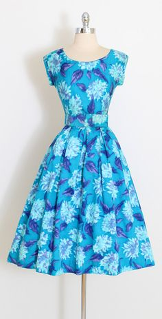 ➳ vintage 1950s dress  * bright blue brushed cotton * watercolor floral print * bow tie detachable belt * metal back zipper * by Jerry Gilden  condition | excellent  fits like xs/s  length 43 bodice length 16 bust 36 waist 26 hem allowance 2.5  ➳ shop http://www.etsy.com/shop/millstreetvintage?ref=si_shop  ➳ shop policies http://www.etsy.com/shop/millstreetvintage/policy  twitter | MillStVintage facebook | millstreetvintage instagram | m...