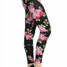 """Black Pants All over floral Multi color Leggings Black Pants All over floral Multi color Leggings  Model is 5'3"""" wearing size small Looking for the perfect combination of something sexy, sweet and sophisticated? Look no further. These pants take leggings to the next level! Effortless style and comfort no matter how you choose to spend your time! Pants Leggings"""