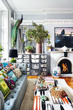 14 Small Space Hacks to Make Your Studio Apt Seem HUGE Amazing eclectic living room with fireplace and a lot of storage place. Love the colorful pillows and the elegant design of the couch! Interior Exterior, Home Interior, Bathroom Interior, Modern Interior, Japanese Interior, Living Room Decor Eclectic, Eclectic Lamps, Bohemian Apartment, Bedroom Apartment