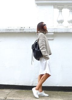 effortless style with distressed white denim skirt and white sneakers