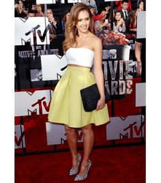 Tip: Dare to bare skin with a crop top and full skirt.    At the 2014 MTV Movie Awards, Alba offered a subtle way to try the crop top trend in a white Piece d'Anarchive top and high-waisted Kenzo Pleated Neon Neoprene Mini Skirt ($505, available in Coral), finishing the look with Bottletop by Narciso Rodriguez's Jessica Hand-Braided Clutch ($1000) and Jimmy Choo Abel Woven Point-Toe Pumps ($688).