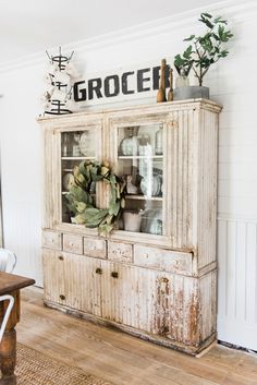 Primitive dining room hutch. Neutral farmhouse dining room. Shiplap walls…