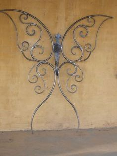 Enhance the beauty of your interior by using the metal tree wall art Steel Gate Design, Iron Gate Design, Wrought Iron Decor, Wrought Iron Gates, Metal Tree Wall Art, Scrap Metal Art, Metal Projects, Metal Crafts, Tribal Butterfly