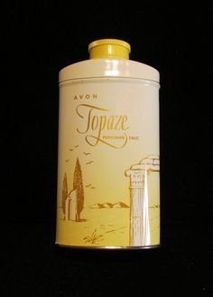This is a vintage 1960's 2.75 ounce tin of Avon Topaze Perfumed Talc that is in great condition, and is full and unused. The tin has no dents, dings, rust or corrosion; and is in excellent condition.