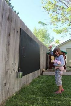 OMG ~ Make this pronto!!!  Outdoor chalk board: Birch plywood, primed on both sides then coat one side with chalkboard paint {2tbsp un-sanded grout + 1 quart any color paint -OR- 1tbsp un-sanded grout to 1/2 cup paint, for smaller projects}.  Hang on fence with galvanized wood screws.  AWESOME outdoor fun for the kids and easy to keep an eye on them from the patio.  LOVE, LOVE, LOVE!