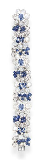 A SAPPHIRE, DIAMOND AND FRESHWATER PEARL BRACELET, BY SEAMAN SCHEPPS   Designed as a flexible band of flowers and 18k white gold openwork foliate clusters set with vari-cut sapphires, circular-cut diamonds, freshwater and cultured pearls, 7½ ins., in a Seaman Schepps tan suede pouch  Signed Seaman Schepps, no. 11158