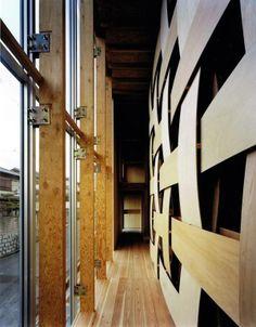 Glass facade with wooden columns