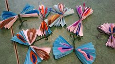 Butterflies! Our class made these lovely butterflies by gluing tissue paper circles to construction paper then accordion folding them. Add a pipe cleaner and, done!